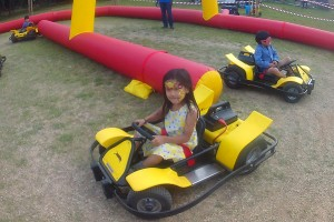 electric go karting party on grass at summer fair